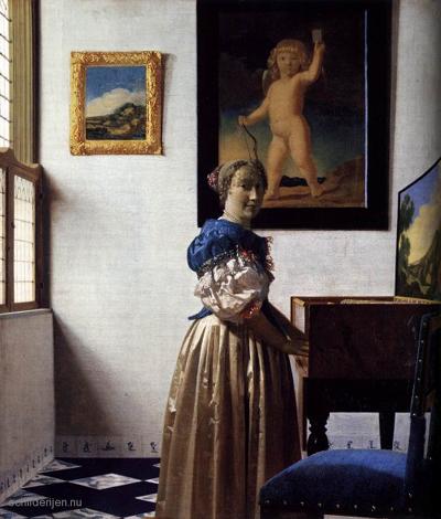 Staande virginaalspeelster geschilderd door Johannes Vermeer rond 1670-1673